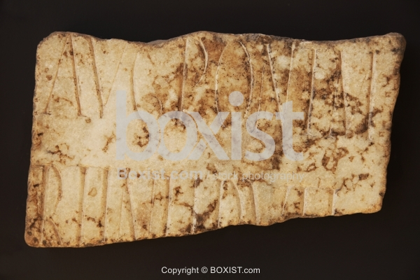 Fragment of Old Latin Script AUG and PON Carved Into Marble Stone