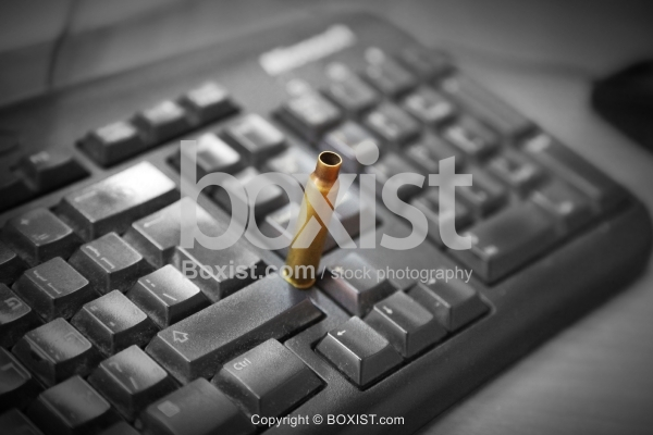 Bullet Shell on Computer Keyboard