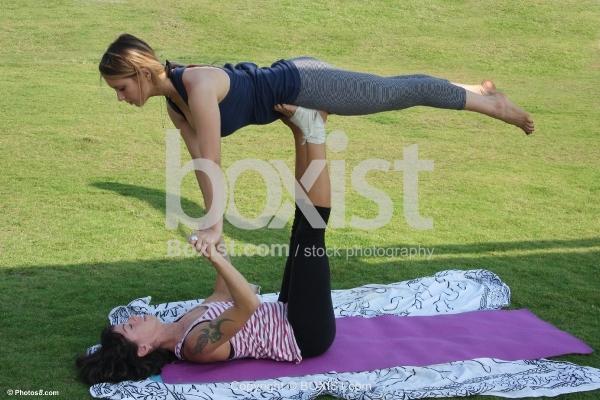 Two Acrobatic Girls Exercising