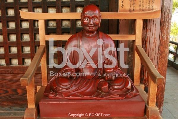 Buddhist Monk Red Statue in Fujiyoshida