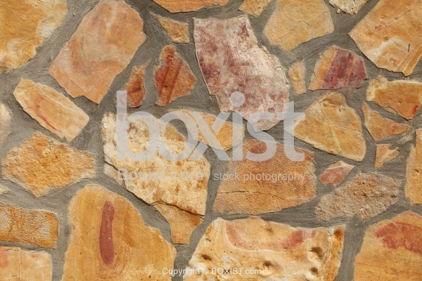Smooth Stones with Cement Wall