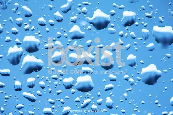 Rain Water Drops on Winter Glass