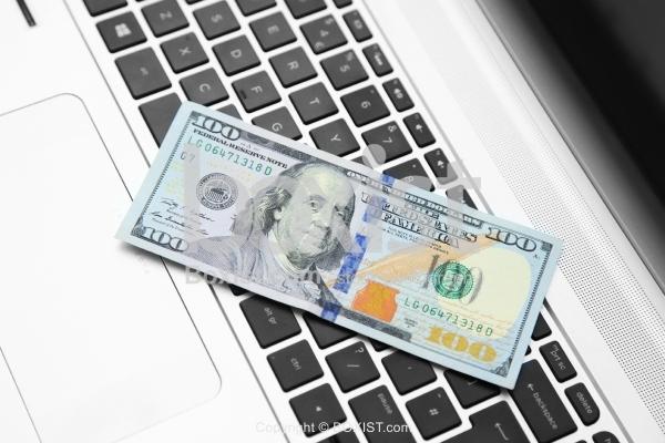 Laptop Keyboard With 100 Dollar Bill