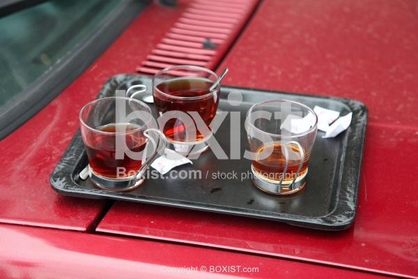Tea Cups on Car Hood