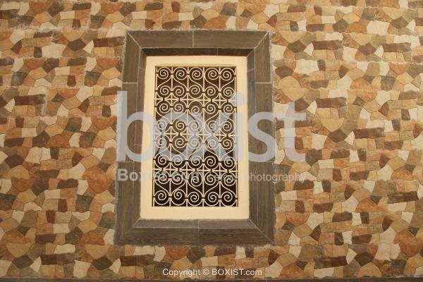 Window On Geometric Stones Wall