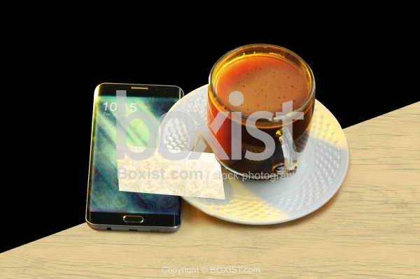Coffee Cup With Smartphone On Table