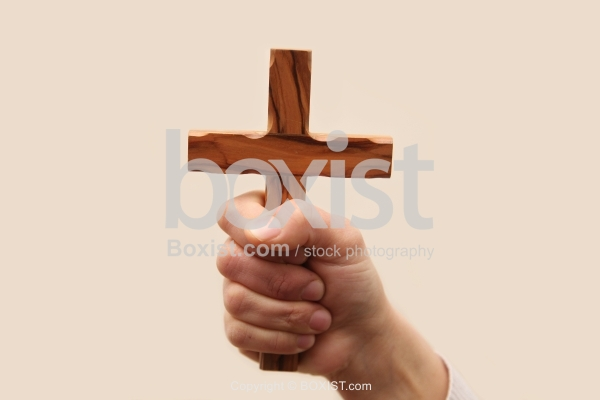 Hand Holding Cross