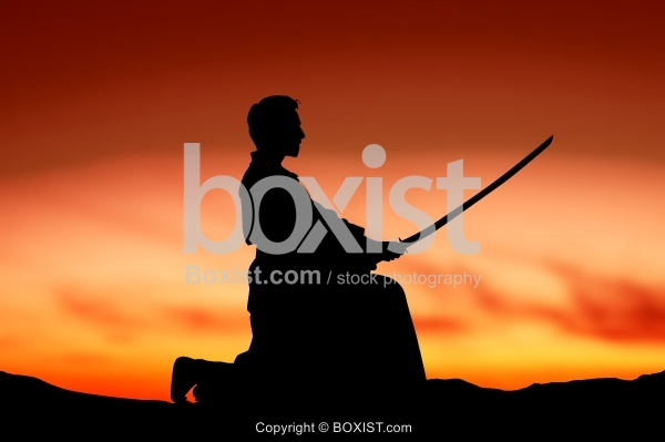 Japanese Swordsman Training At Sunset