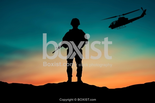 Soldier and Helicopter At Sunset