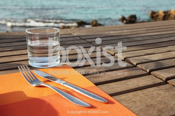 Fork and Knife with Water Cup on Table