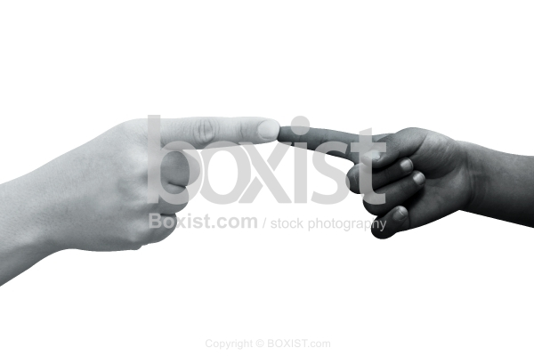 Hand of Black Child Pointing To White Hand