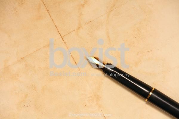 Manuscript Pen On Grunge Paper