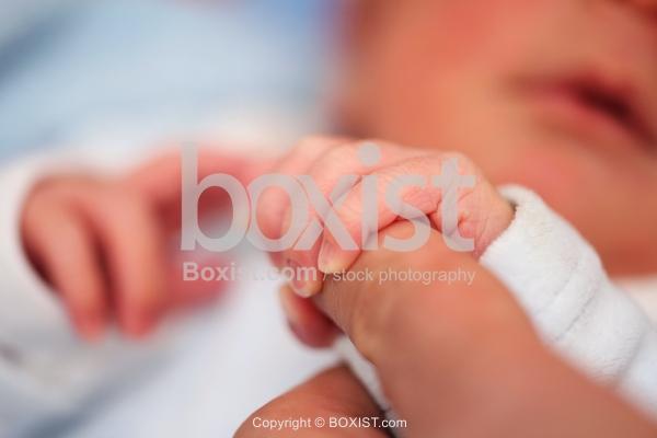 Newborn Baby Holding Finger