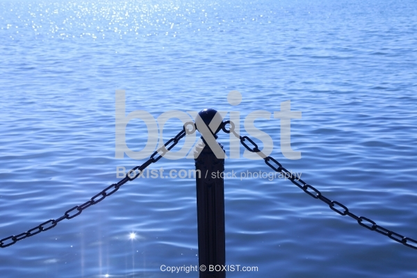 Post And Chain Fence On Water