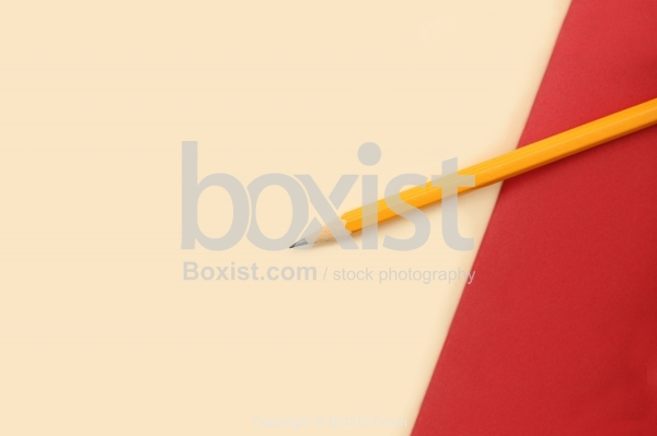 Yellow Pencil On Paper Background