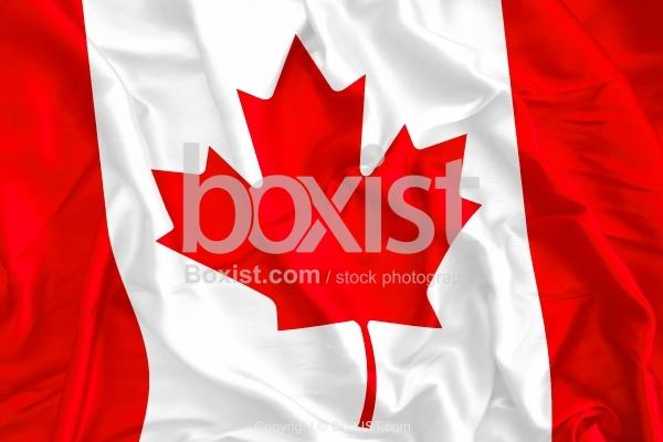 Waving Canada Flag On Silk Background