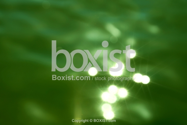 Shiny Bokeh On Green Water