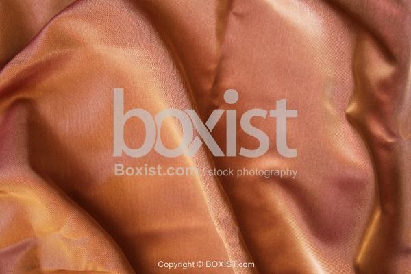 Shiny Golden Brown Wavy Silk Background