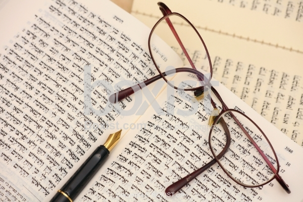 Torah Bible Book with Reading Glasses and Pen