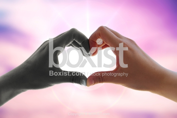 Two Black and White Hands in the Shape of Love Heart