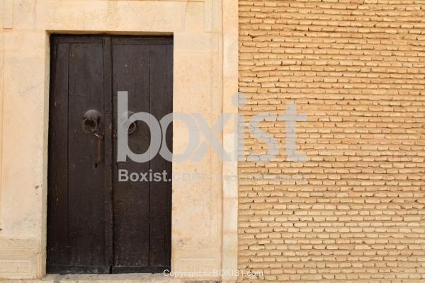 Wooden Door And Bricks Wall