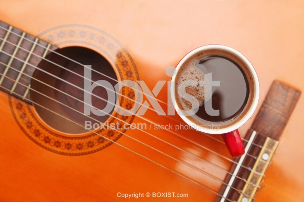 Cup Of Black Coffee And Acoustic Guitar