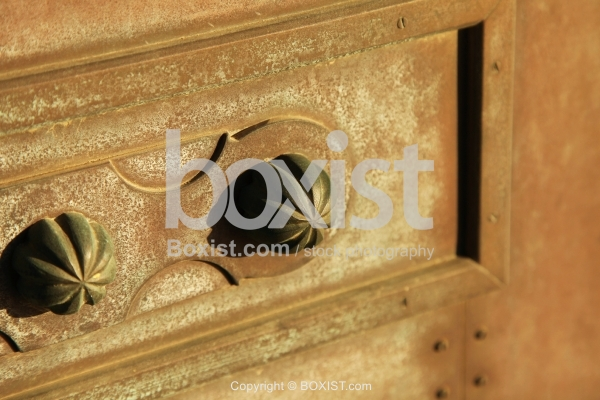 Decorative Metal Bolts On Rusty Door