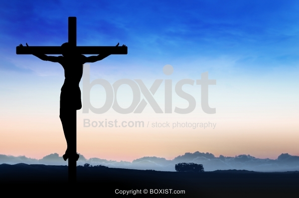 Jesus On Cross Over Field At Sunset