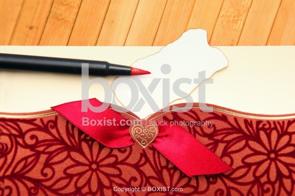 Red Pen On Ornamental Greeting Card
