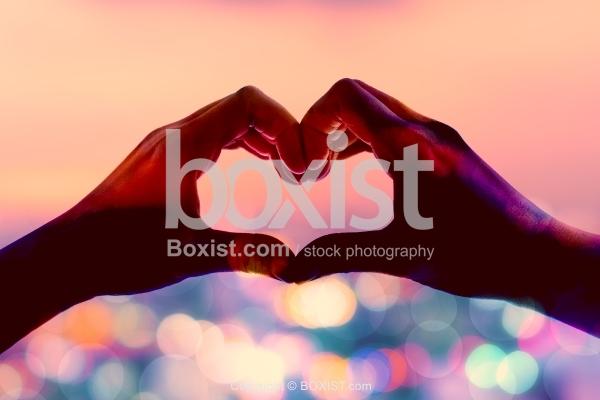 Hand Heart Shape Against Bokeh Background