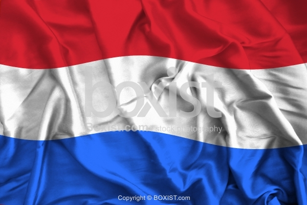 Netherlands Flag On Soft And Smooth Silk Background