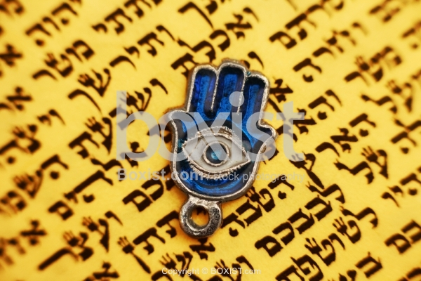 Protection Hamsa Hand on Jewish Torah Text