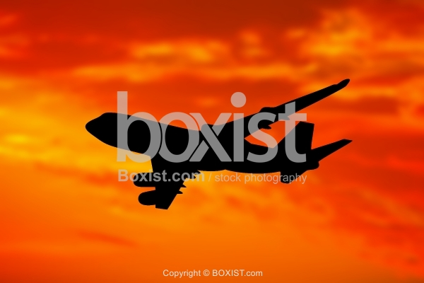 Commercial Airplane Silhouette At Sunset