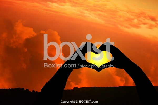 Concept Heart Shape of Hands Silhouette At Sunset