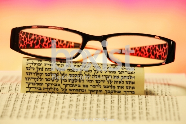 Glasses And Hebrew Torah Rolled Scroll.