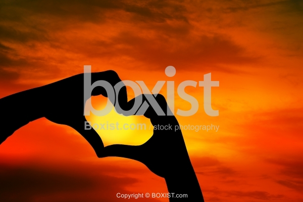 Love Heart Shape Concept of Two Hands At Sunset