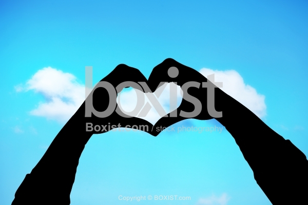 Love Hands Silhouette On Blue Sky