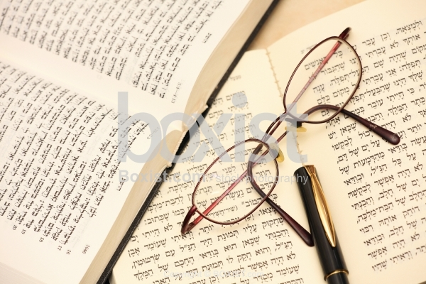 Pen And Glasses On Open Torah Book