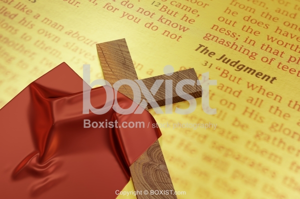 Wooden Cross Covered With Red Cloth On Bible Book
