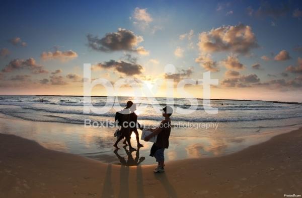Walking Along Beach Sunset