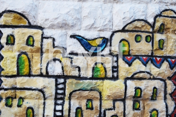 Wall Painting of Bird over Old Houses