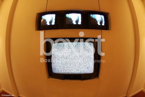 Wall with TV Monitors