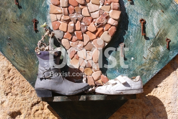 Wall with Used Shoes