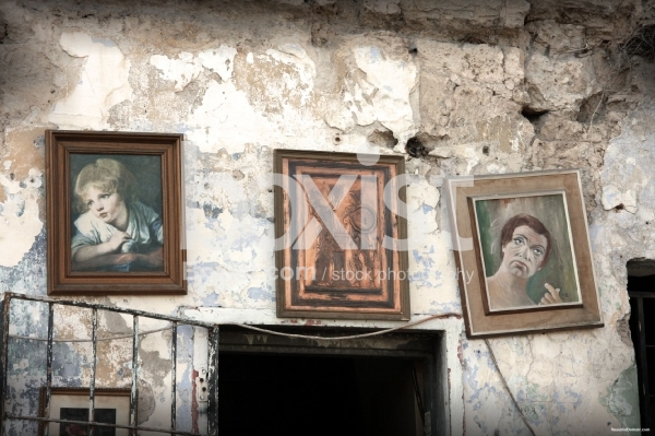 Grunge Ruined Wall with Hanged Paintings